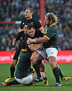 JOHANNESBURG, South Africa, 25 July 2015 : Israel Dagg of the All Blacks is tackled by Francois Louw and Jannie du Plessis of the Springboks during the Castle Lager Rugby Championship test match between SOUTH AFRICA and NEW ZEALAND at Emirates Airline Park in Johannesburg, South Africa on 25 July 2015. Bokke 20 - 27 All Blacks<br /> <br /> © Anton de Villiers / SASPA