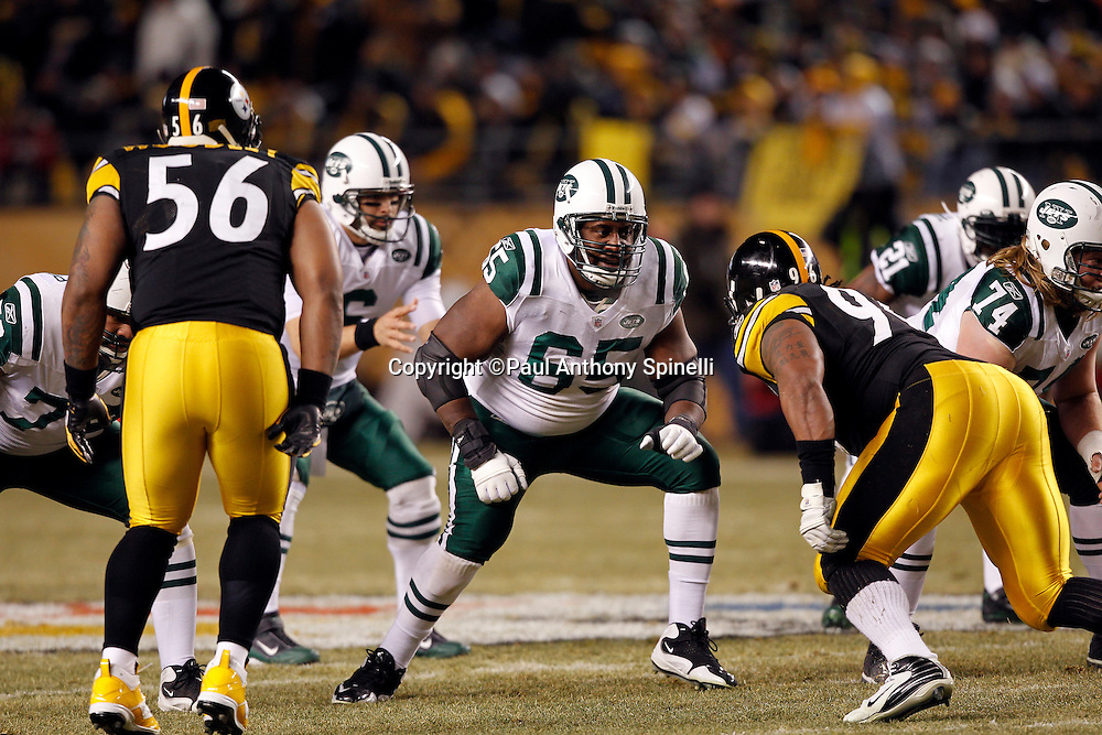 New York Jets guard Brandon Moore (65) blocks during the NFL 2011 AFC Championship playoff football game against the Pittsburgh Steelers on Sunday, January 23, 2011 in Pittsburgh, Pennsylvania. The Steelers won the game 24-19. (©Paul Anthony Spinelli)