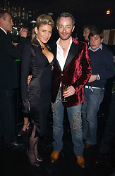 Fashion designer SCOTT HENSHALL and HOFIT GOLAN at the 40th birthday party and celebration of 20 years as a leading stylist of David Thomas held at Too2Much club, 11 Walkers Court, London W1 on 22nd March 2006.<br /><br />NON EXCLUSIVE - WORLD RIGHTS