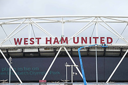 West Ham United Football Club's lettering is re installed on the front of their home ground - the London Stadium at Queen Elizabeth Olympic Park,Stratford after they were taken down while the IAAF World Championships 2017 was being held there. (Photo by Claire Doherty)