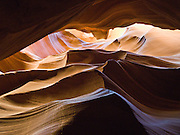 "Flash floods have eroded a slot of Navajo sandstone into a natural cathedral at Upper Antelope Canyon, in Antelope Canyon Navajo Tribal Park, Page, Arizona, USA. (The older spelling ""Navaho"" is no longer used by the Navajo, an American Indian group who call themselves Diné, or Dineh, ""The People."")"