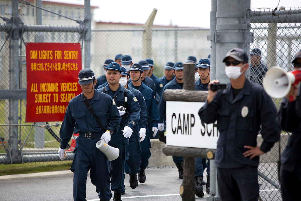 OKINAWA, JAPAN - JUNE 17 : Police ready to remove the  the Anti U.S. Base protesters from blocking the gate during a demonstration outside the Camp Schwab on June 17, 2016 in Nago, Okinawa, Japan. Protests have grown more intense in the past days due to the past incident of rape of a Japanese woman and drunk driving in Okinawa over American military presence in Japan. Photo: Richard A. de Guzman