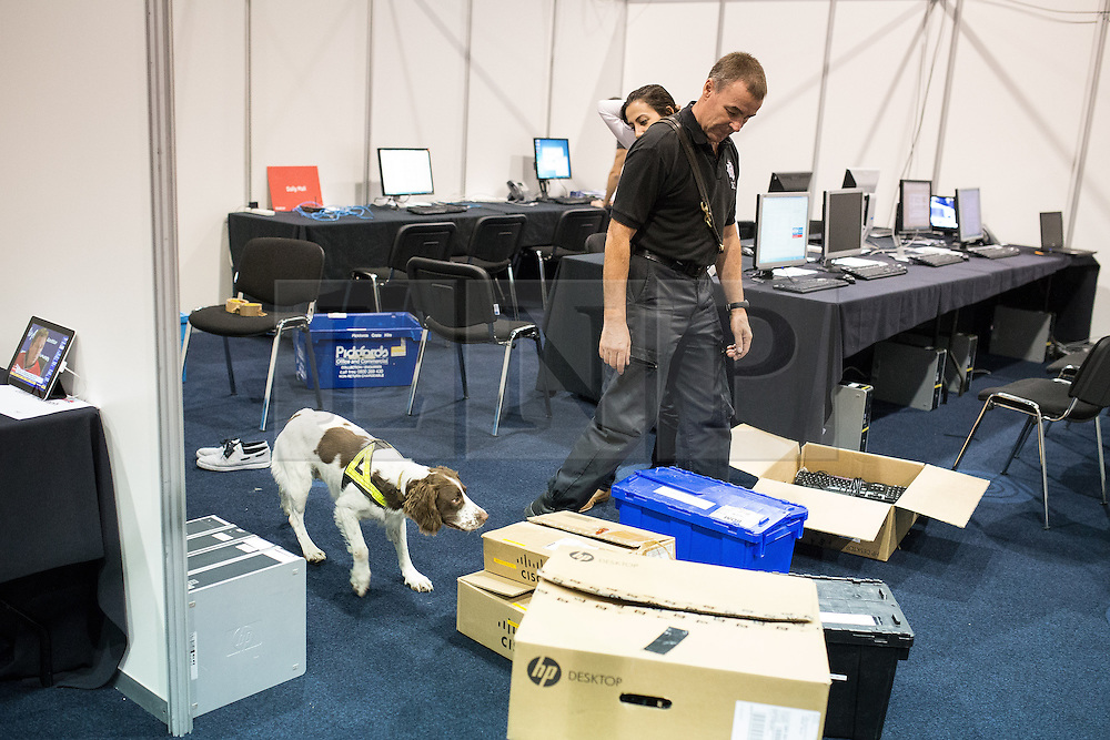 © Licensed to London News Pictures . 28/09/2013 . Manchester , UK . Police with sniffer dogs check security inside the conference venue . Preparations ahead of the Conservative Party annual conference in Manchester , today (Saturday 28th September 2013) . Photo credit : Joel Goodman/LNP