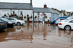 © Licensed to London News Pictures. 26/10/2019. Crickhowell, Powys, Wales, UK. The Bridge End Inn car park gets flooded as rain falls relentlessly and the level of the river Usk rises dramatically. Water enters The Bridge End Inn basement in Bridge Street, Crickhowell  in Powys. Photo credit: Graham M. Lawrence/LNP