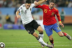 07.07.2010, Moses Mabhida Stadium, Durban, SOUTH AFRICA, Deutschland ( GER ) vs Spanien ( ESP ) im Bild Mesut Oezil of Germany and Sergio Ramos  of Spain  .Foto ©  nph /  Kokenge / SPORTIDA PHOTO AGENCY