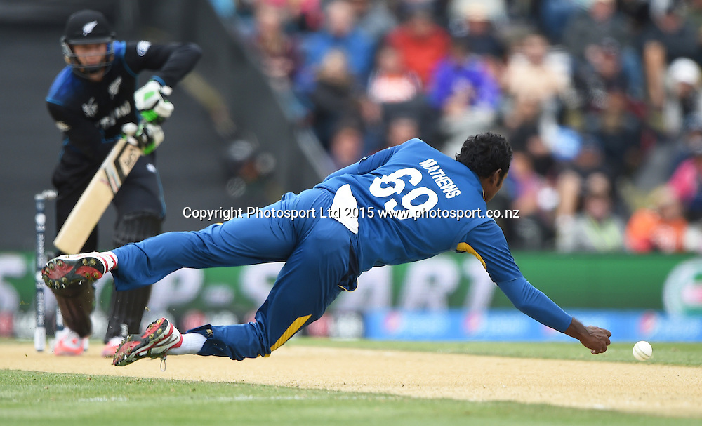 Angelo Mathews fields off his own blowing during the ICC Cricket World Cup match between New Zealand and Sri Lanka at Hagley Oval in Christchurch, New Zealand. Saturday 14 February 2015. Copyright Photo: Andrew Cornaga / www.Photosport.co.nz