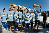 "The over 40 team The Bumbles- ""bounced back"" as Jeff Kruger, Glenn Fusonie, Frank Cirone, Jay Turmel, Walt Cammack and Joe Galea  take the coveted Cup after sudden death overtime play for the Championship game at the New England Pond Hockey Classic on Sunday afternoon.  (Karen Bobotas/for the Laconia Daily Sun)"