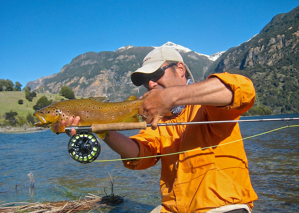 A handsome pair, both in brilliant orange. Guide Esteban Osorio shows us how it's done on Lago Elizalde, Patagonia, Chile. The brown trout was released.