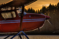 A red seaplane at sunrise, Kodiak, Alaska