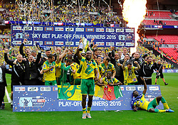 Norwich City's Cameron Jerome dances in front of team mates with the trophy as Norwich City win promotion to the premier league   - Photo mandatory by-line: Joe Meredith/JMP - Mobile: 07966 386802 - 25/05/2015 - SPORT - Football - London - Wembley Stadium - Middlesbrough v Norwich - Sky Bet Championship - Play-Off Final