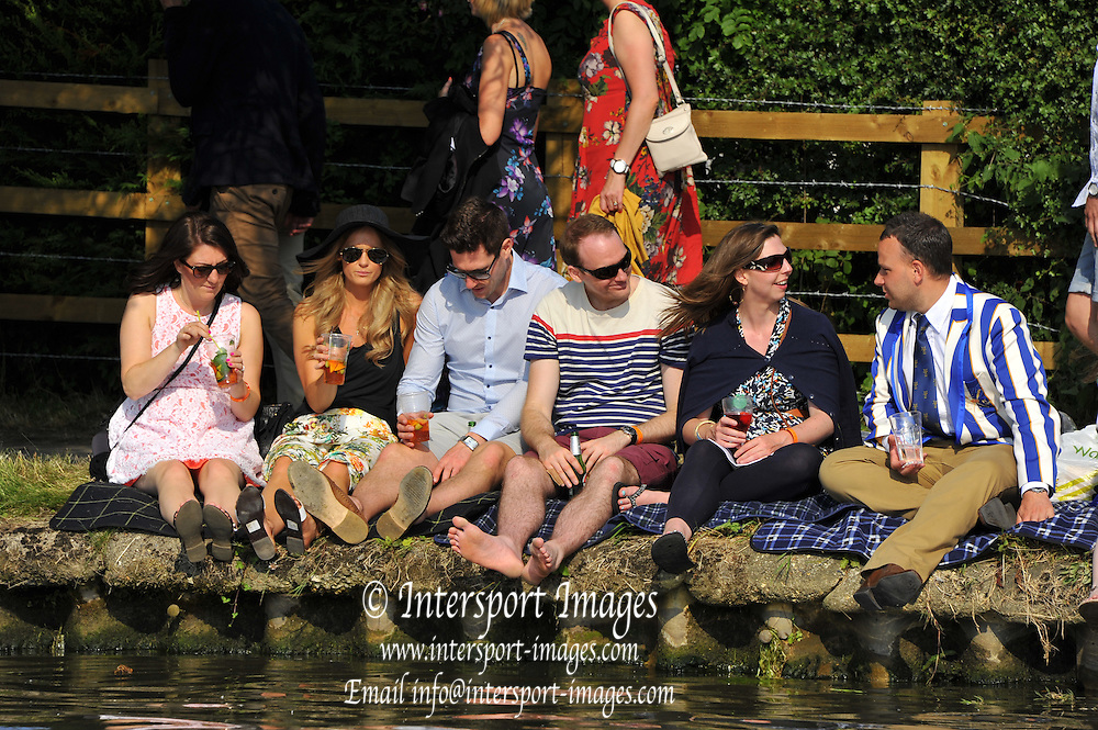 Henley on Thames. United Kingdom. Spectators picnicking on the river bank. 2013 Henley Royal Regatta, Henley Reach. 17:30:58  Thursday  04/07/2013  [Mandatory Credit; Peter Spurrier/ Intersport Images]