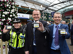 Pictured: British Transport police Chief Inspector Sue Maxwell, Scotrail Managing Director Alex Hynes and CEO of camera designers Ede Six Ltd Richie McBride with the new cameras.<br /> <br /> Scotrail unveils new &pound;300,000 GBP personal cctv cameras for their front-line staff to wear. This is in response to increased assaults on staff members across the network, and will see over 350 camera equipped staff across Scotland.<br /> <br /> (c) Dave Johnston / Eem