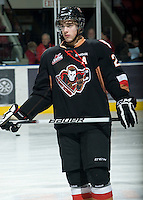 KELOWNA, CANADA, JANUARY 1: Collin Bowman #28 of the Calgary Hitmen stands on the ice during warm up as the Calgary Hitmen visit the Kelowna Rockets on January 1, 2012 at Prospera Place in Kelowna, British Columbia, Canada (Photo by Marissa Baecker/Getty Images) *** Local Caption ***