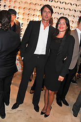 BRETT ANDERSON and his wife JODIE at the launch of the Spencer Hart Flagship store, Brook Steet, London on 13th September 2011.
