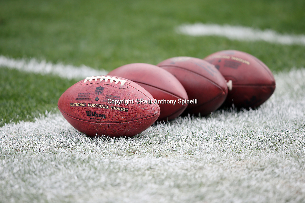 Four footballs lie on the grass during pregame warmups before the Pittsburgh Steelers 2015 NFL week 6 regular season football game against the Arizona Cardinals on Sunday, Oct. 18, 2015 in Pittsburgh. The Steelers won the game 25-13. (©Paul Anthony Spinelli)