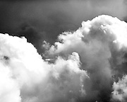 Child in the clouds outside Syracuse New York