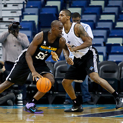 December 17, 2011; New Orleans, LA, USA; New Orleans Hornets black team center Emeka Okafor (50) drives past New Orleans Hornets white team forward Lance Thomas (42) during a scrimmage at the New Orleans Arena.   Mandatory Credit: Derick E. Hingle-US PRESSWIRE