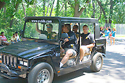 Security police patrolling festival in doorless SUV. Hmong Sports Festival McMurray Field St Paul Minnesota USA