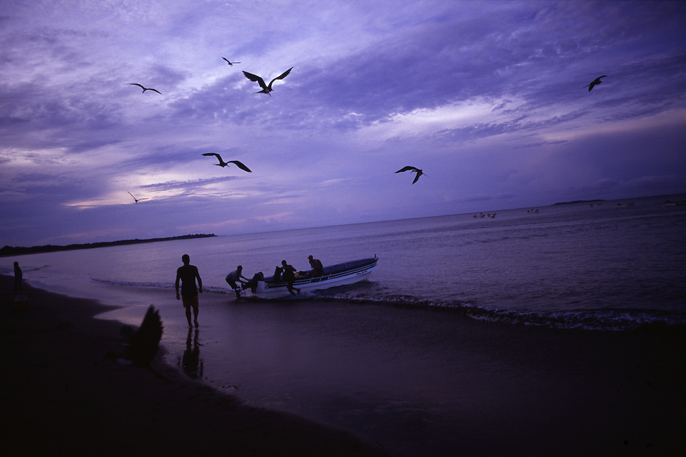 Fishermen prepare their boats as night falls on Playa Arenal near Pedasi, Panama. The beach is the staging point for many trips to Isla Iguana.