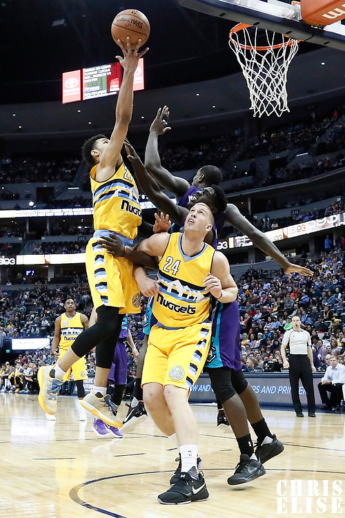 04 March 2017: Denver Nuggets forward Wilson Chandler (21) goes for the layup against Charlotte Hornets forward Marvin Williams (2) during the Charlotte Hornets 112-102 victory over the Denver Nuggets, at the Pepsi Center, Denver, Colorado, USA.