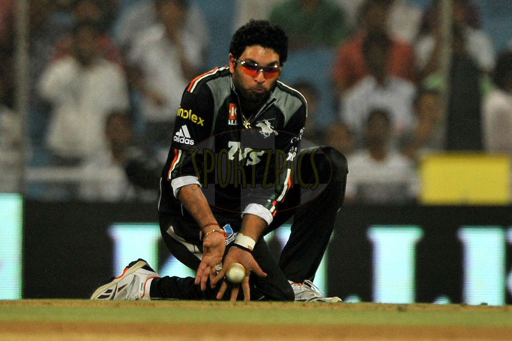 Yuvraj Singh Captain of Pune Warriors India fields during  match 10 of the Indian Premier League ( IPL ) Season 4 between the Pune Warriors and the Kochi Tuskers Kerala held at the Dr DY Patil Sports Academy, Mumbai India on the 12th April 2011..Photo by Pal Pillai /BCCI/SPORTZPICS