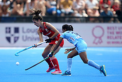 England's Anna Toman and India's Reena Kokhar (right) during the Vitality Women's Hockey World Cup pool B match at The Lee Valley Hockey and Tennis Centre, London.