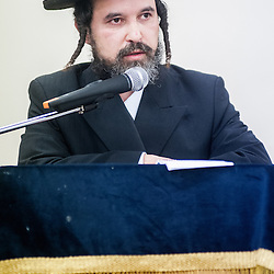 London, UK - 3 December 2014: a memeber of the community speaks as Mr Stephen Williams MP, Parliamentary Under Secretary of State for Communities and Local Government, visits Talmud-Torah Yetev-Lev orthodox Jewish school in Hackney, London