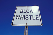 Street sign reading 'Blow whistle', 2000's