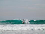 Server riding a wave.