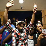 Charlotte, NC- September 21, 2016: Protestors try to provoke officers inside the Charlotte Mecklenburg Police deptarment in Uptown Charlotte, NC. The protest started at Marshall Park and continued on to center city. CREDIT: LOGAN R. CYRUS FOR THE NEW YORK TIMES