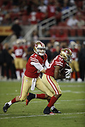 San Francisco 49ers running back Jeremy McNichols (33) and San Francisco 49ers quarterback Jack Heneghan (6) in action during the 2018 NFL preseason week 4 football game against the Los Angeles Chargers on Thursday, Aug. 30, 2018 in Santa Clara, Calif. The Chargers won the game 23-21. (©Paul Anthony Spinelli)
