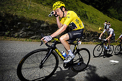 July 19, 2018 - Alpe D'Huez, France - British GERAINT THOMAS of Team Sky removes his glasses to clear sweat from his eyes, during the twelfth stage in the 105th edition of the Tour de France cycling race, 175,5km from Bourg-Saint-Maurice Les Arcs to Alpe d'Huez. This year's Tour de France takes place from July 7th to July 29th. (Credit Image: © Yorick Jansens/Belga via ZUMA Press)