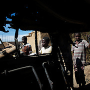 January 21, 2013 - Diabaly, Mali: Local children scavenge destroyed islamic militants' armoured vehicles in central Diabaly, a day after Mali government troops regain control of the city. Diabaly was under islamist militants control since the 14th of January...Several insurgent groups have been fighting a campaign against the Malian government for independence or greater autonomy for northern Mali, an area known as Azawad. The National Movement for the Liberation of Azawad (MNLA), an organisation fighting to make Azawad an independent homeland for the Tuareg people, had taken control of the region by April 2012...The Malian government pledge to the French army to help the national troops to stop the rebellion advance towards the capital Bamako. The french troops started aerial attacks on rebel positions in the centre of the country and deployed several hundred special forces men to counter attack the advance on the ground. (Paulo Nunes dos Santos/Polaris)