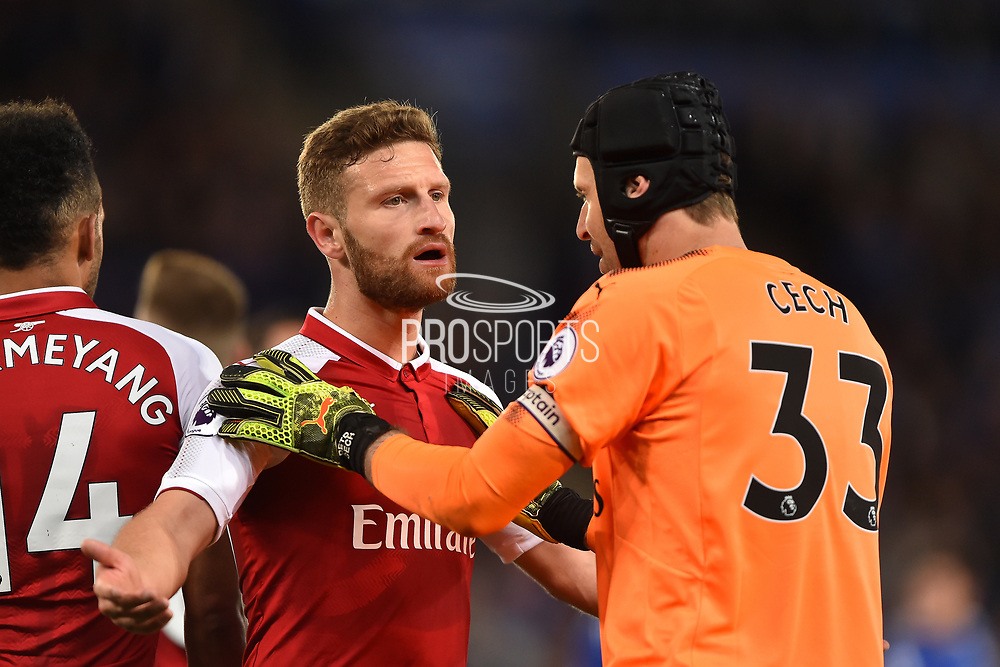 Arsenal goalkeeper Petr Cech (33) try to calm down Arsenal defender Shkodran Mustafi (20) during the Premier League match between Leicester City and Arsenal at the King Power Stadium, Leicester, England on 9 May 2018. Picture by Jon Hobley.