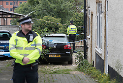 © Licensed to London News Pictures. 19/09/2016. High Wycombe, UK. Police stand outside a property in High Wycombe, Buckinghamshire, where detectives have launched a murder investigation following the death of a woman. A man has been arrested on suspicion of murder. Photo credit: Peter Macdiarmid/LNP