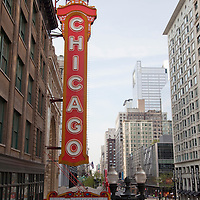 Chicago Theater sign and buildings along North State Street in downtown Chicago Loop. Photo is vertical and high resolution.