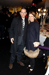 MR & MRS JONATHAN NEWHOUSE at a party to celebrate The World of Alber Elbaz for Lanvin at Harvey Nichols, Knightsbridge, London on 1st February 2006.<br />