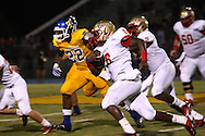 Lafayette High's Tyrell Price (8) vs. Tupelo in Tupelo, Miss. on Friday, August 23, 2013. Tupelo won.