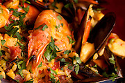 Macro of prawn in paella mix.