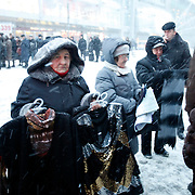 A woman sells clothes during a snow storm outside the Kievskaya metro station on the Moscow Ring Line. .The Moscow Metro, which spans almost the entire Russian capital, is the world's second most heavily used metro system after the Tokyo's twin subway. Opened in 1935, it is well known for the ornate design of many of its stations, which contain outstanding examples of socialist realist art.