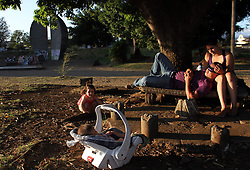 A family rest in a park near the Juan Santamaria International Airport, in Alajuela city, 25km northwest of San Jose, capital of Costa Rica, on Feb. 28, 2015. EXPA Pictures © 2015, PhotoCredit: EXPA/ Photoshot/ [e]KENT GILBERT<br /> <br /> *****ATTENTION - for AUT, SLO, CRO, SRB, BIH, MAZ only*****