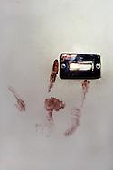 Roma 9 ottobre 1982.Attentato alla Sinagoga di Roma da parte di  un commando palestinese.L'attentato avvenne di sabato mattina, alla fine dello Shemin&igrave; Atzeret che chiude la festa di Sukkot.L'attentato caus&ograve; la morte di Stefano Gay Tach&egrave; di soli due anni ed il ferimento di 37 persone. L'impronta  di sangue della  mano di un ferito nell'attentato.<br /> Rome October 9, 1982.<br /> Attack on the synagogue in Rome by a commando palestinian. Attack was on a Saturday morning, at the end of Shemini Atzeret, which closes the holiday Sukkot.  Attack caused the death of Stefano Gay Tache of  only two years and the wounding of 37 people. The imprint of a hand of blood of a wounded,  escaped  the attack of  commando palestinian in the Synagogue of Rome