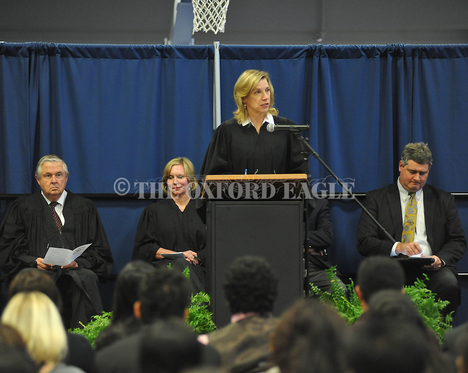 Chief judge Sharion Aycock speaks during a Naturalization Ceremony in U.S. District Court for the Northern District of Mississippi, at Oxford High School in Oxford, Miss. on Tuesday, November 18, 2014. The ceremony was the first the court has ever held at the school.