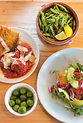 Wood fired edamame, marinated olives, salad and meatballs at Oven and Tap on Friday, February 19, 2016, in Bentonville, Arkansas. Beth Hall for the New York Times