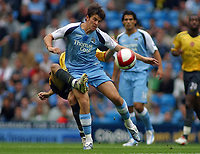 Photo: Paul Thomas.<br /> Manchester City v Arsenal. The Barclays Premiership. 26/08/2006.<br /> <br /> Joey Barton of Man City (R) takes out Cese Fabregas for the ball.