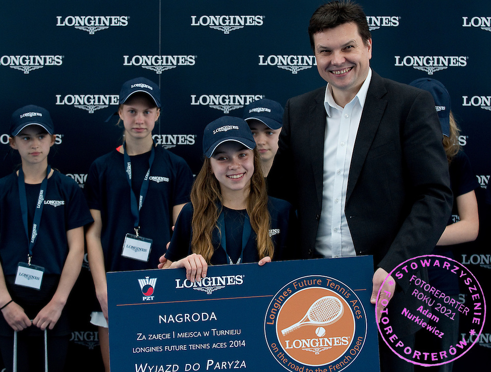 (L) Maja Chwalinska and (R) Leszek Pilch while victory ceremony at the Longines Future Tennis Aces 2014 at Tuan Tennis Club in Jozefoslaw near Warsaw on April 12, 2014.<br /> <br /> Poland, Warsaw, April 12, 2014<br /> <br /> Picture also available in RAW (NEF) or TIFF format on special request.<br /> <br /> For editorial use only. Any commercial or promotional use requires permission.<br /> <br /> Mandatory credit:<br /> Photo by &copy; Adam Nurkiewicz / Mediasport