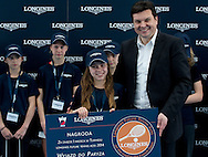 (L) Maja Chwalinska and (R) Leszek Pilch while victory ceremony at the Longines Future Tennis Aces 2014 at Tuan Tennis Club in Jozefoslaw near Warsaw on April 12, 2014.<br /> <br /> Poland, Warsaw, April 12, 2014<br /> <br /> Picture also available in RAW (NEF) or TIFF format on special request.<br /> <br /> For editorial use only. Any commercial or promotional use requires permission.<br /> <br /> Mandatory credit:<br /> Photo by © Adam Nurkiewicz / Mediasport
