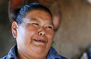 Francine Jose smiles in her outdoor kitchen on her family ranch near the U.S.- Mexico border on the Tohono O'odham reservation in Chukut Kuk, Arizona April 6, 2017. Picture taken April 6, 2017.  REUTERS/Rick Wilking