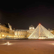 Like Paris's most famous landmark, the Eiffel Tower, The Louvre also lights up at night and becomes a beacon for people to congregate from all over the city