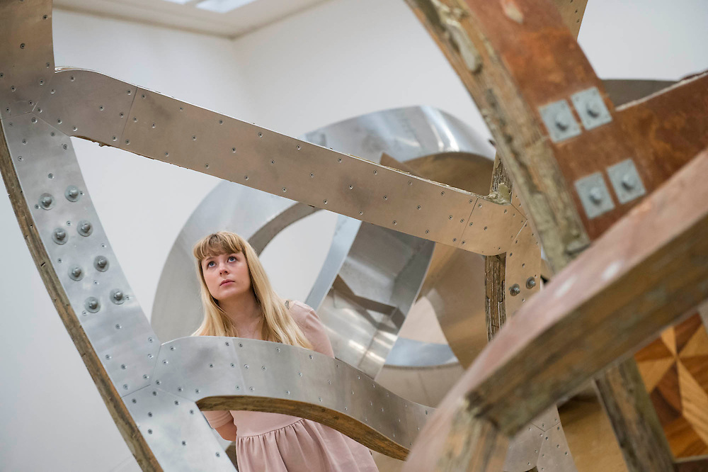 Tate Britain launches its major spring show, exhibiting the work of Turner Prize-winning artist Richard Deacon (b.1949). It includes large sculptures made of twisted wood, metal, and ceramic such as: Fold 2012, a towering sculpture weighing over 12 tonnes and made of 60 shimmering glazed ceramic bricks; After 1998, a huge serpentine wooden structure that is over 9 metres at its longest point; Lock 1990  (pictured); and Out of Order 2003, a sprawling sculpture constructed from ribbons of steamed wood. The Tate Britain, London, UK 03 February 2014. Guy Bell, 07771 786236, guy@gbphotos.com